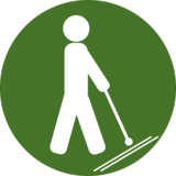 This pictogram shows a person with a cane for the blind and stands in the project for needs of blind people.