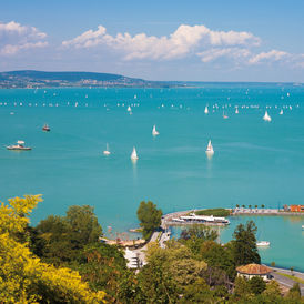 "The picture shows Lake Balaton in Hungary, which is one of the project areas of ""Nature without Barriers"". The sun is shining, many ships sail on the lake."