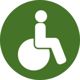 This pictogram shows a person in a wheelchair and stands in the project for the needs of peple who cannot walk.